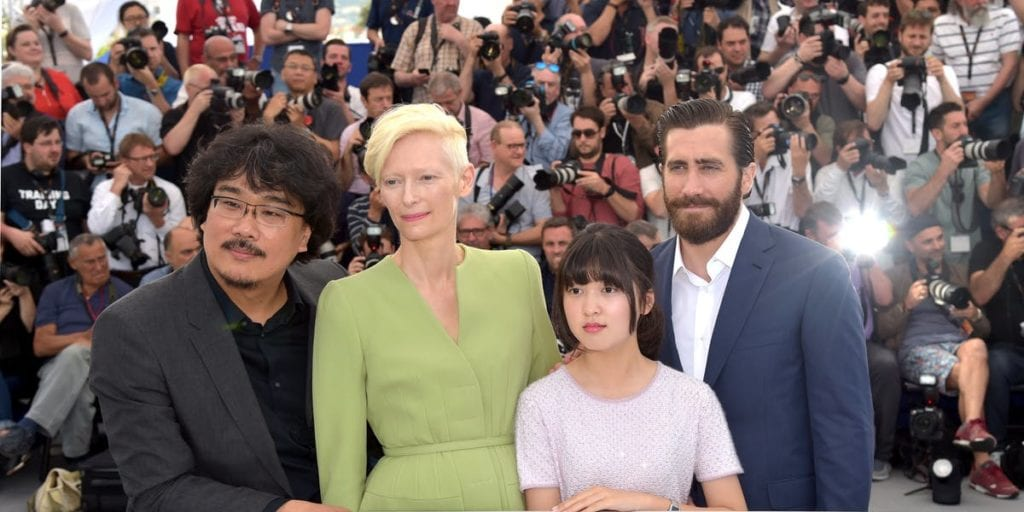 Bong Joon-ho, left, and the cast of Okja.