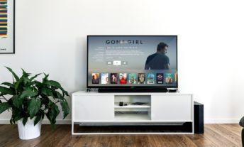 living room with a tv featuring the movie Gone Girl